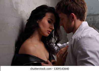 Unhappy disappointed beautiful woman hugging her husband with deep thinking eyes . Closeup art drama emotional portrait.