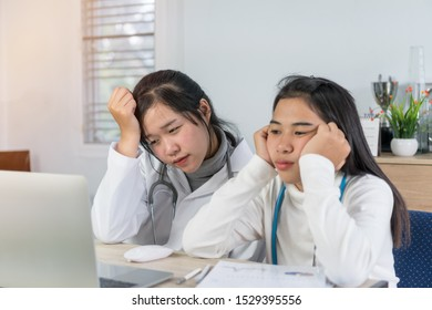 Unhappy female doctor seem sad, stressed, burnout stress and upset in online treatment results on laptop desk consultation in hospital office. Depression,disappointment,worried,pressure in clinic.