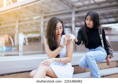 Unhappy female support and comforting girl friend,Friends giving tissue to depressed asian woman,Mental health care concept