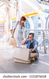Unhappy frustrated tourist searching and forget something having problem