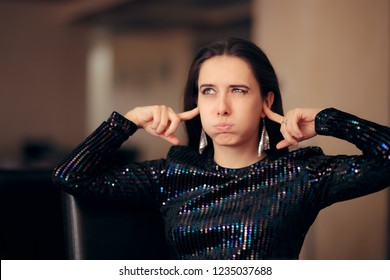 Unhappy Girl Hating the Loud Bad Music at a Party. Woman plugging her ears trying to cover loud noise