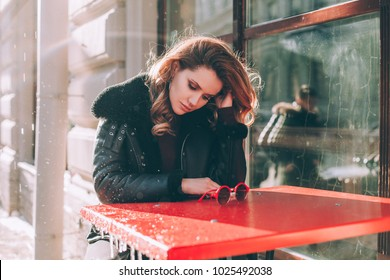 Unhappy Girl in Street Cafe Outdoors. Sad Woman Alone