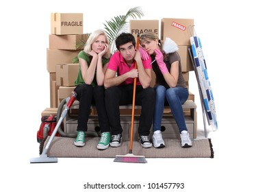 Unhappy housemates cleaning their flat before moving out