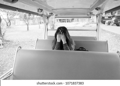 Unhappy lonely depressed woman , Concept of homesickness on bus seat transportation scene.