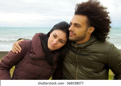 Unhappy man and woman hugging tight