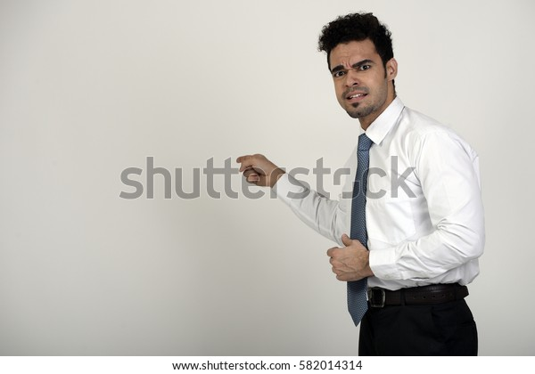 Unhappy manager pointing at the wall