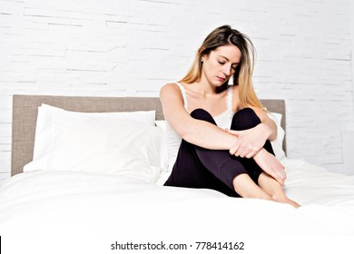 A unhappy mature female in bed at bedroom