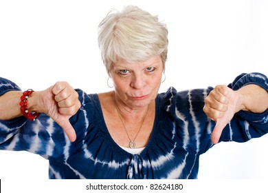 Unhappy mature white haired woman with two thumbs down.