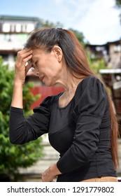Unhappy Old Asian Female Senior