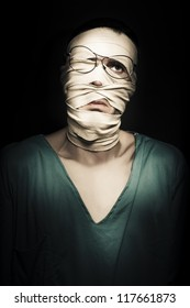 Unhappy Patient With Broken Face Wrapped In Tourniquet Dressing Expressing Distress In A Depiction Of Post Traumatic Stress Disorder PTSD