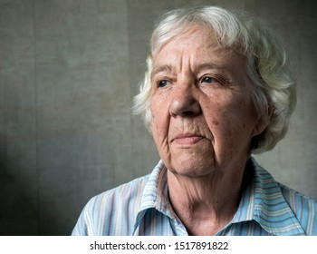Unhappy sad elderly woman close-up portrait