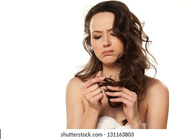 unhappy and sad girl because of her damaged hair