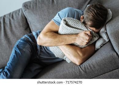 Unhappy sad man crying