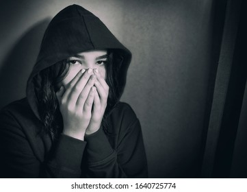 Unhappy teen girl at home in the room