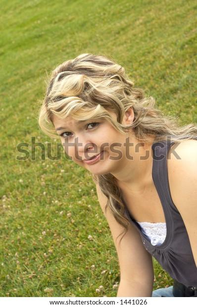 unhappy teen on grass