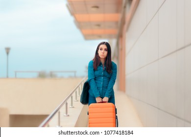 Unhappy Tired Woman At Airport Station with Suitcase. Exhausted travel girl carrying her baggage alone