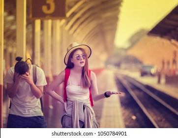 Unhappy traveler showing frustration and shock with miss a train.