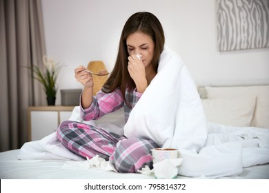 Unhappy woman after breakup eating ice-cream at home
