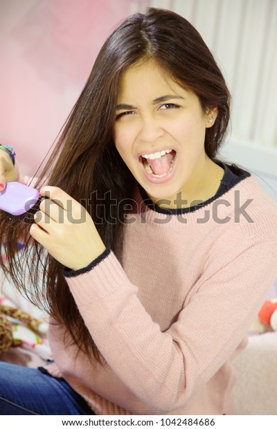 unhappy woman with long hair problem with knot