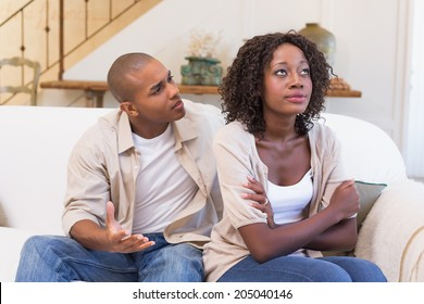 Unhappy woman not listening to his excuses at home in the living room