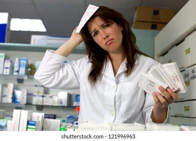 Unhappy woman pharmacist desperate in pharmacy