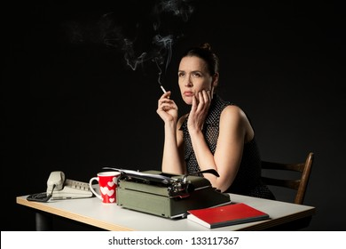 An unhappy woman in a retro work desk