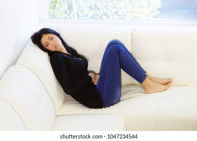 Unhappy woman with stomach ache
