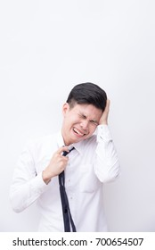Unhappy young business man being sad as cry,right hand pull necktie  and left hand hold head with white background and copyspace.