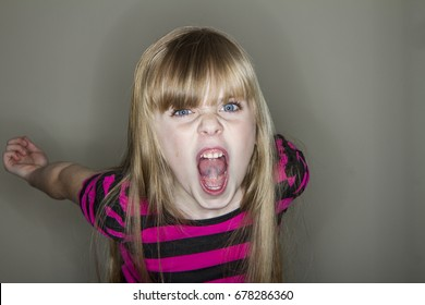 unhappy young little girl yelling
