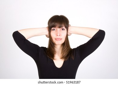 unhappy young woman covering her ears