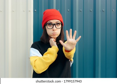 Unhappy Young Woman Making Stop Gesture with Hand. Assertive girl expressing disapproval and rejection