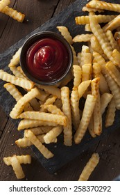 Unhealthy Baked Crinkle French Fries with Ketchup