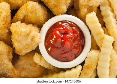 Unhealthy Chicken Nuggets and Fries on a Plate