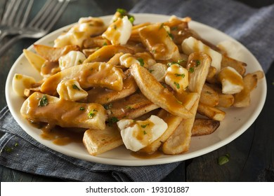 Unhealthy Delicious Poutine with French Fries and Gravy