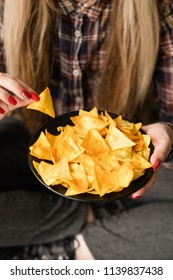 unhealthy fast food snacks. bad nutrition habits. woman eating crispy delicious nacho chips