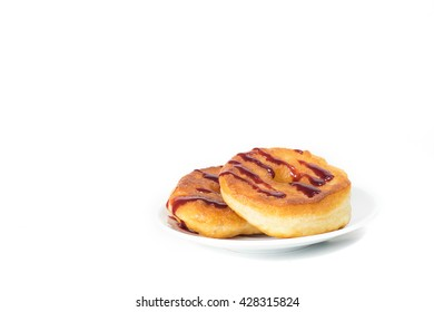 Unhealthy fat donuts with a berry jam in a white plate isolated on white background