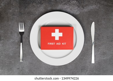 Unhealthy food or Allergy food concept. Plate and first aid kit.