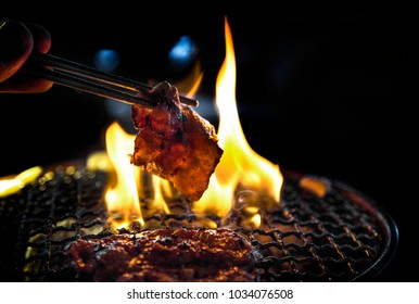 unhealthy food with grilled  pork slice on fire in dinner