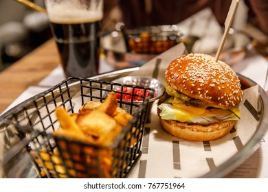 Unhealthy food, high fat and carbs burger and beer