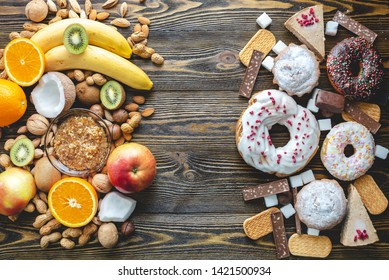 Unhealthy and healthy sweets on wooden background. Organic and dietary food and the problem of refusal from harmful desserts. Fruits and nuts vs donuts cupcakes and candy