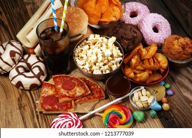 Unhealthy products. food bad for figure, skin, heart and teeth. Assortment of fast carbohydrates food. American unhealthy food.