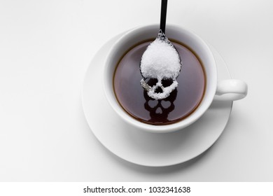 unhealthy white sugar concept. Scull spoon with sugar and cup of black coffee