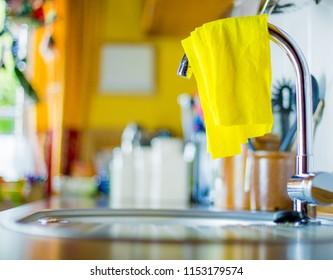 An unhygienic dishcloth lies on a sink