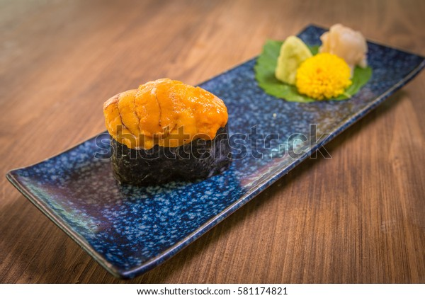 Uni Sushi served on plate with wasabi and ginger