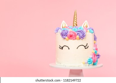 Unicorn cake decorated with multicolor buttercream icing.