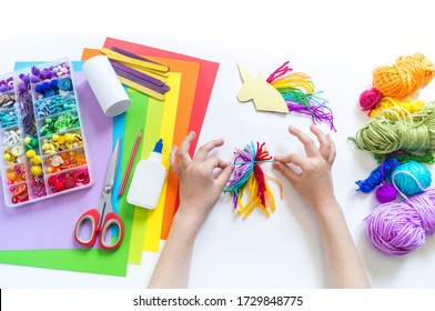 Unicorn cardboard and paper craft. Children's hands do. How to entertain a child. Kindergarten and school