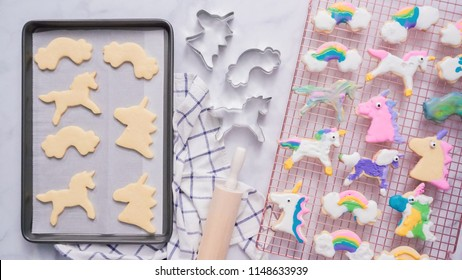 Unicorn cookies decorated with royal icing drying on drying rack.