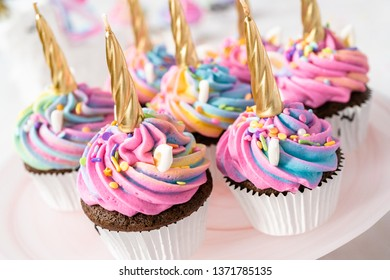 Unicorn cupcakes decorated with colorful buttercream icing and sprinkles.