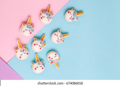 Unicorn macaron cookies on a geometric pastel background