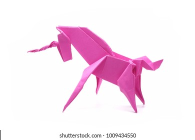 Unicorn : Origami pink unicorn. Isolated on white background.
